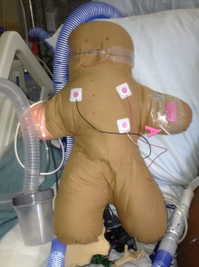 "Child with asthma created this ""mini me"" complete with pulsox, cardiac leads, IV, and high flow nasal cannula."