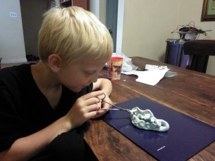 My son practicing pulling out the tooth.  Model magic teeth and a pair of clamps. Tweezers would work too.